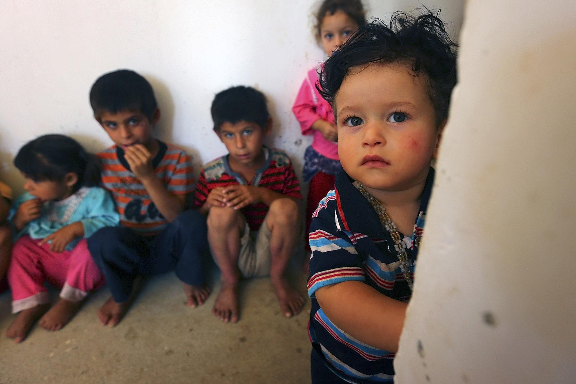 Mideast Iraq Fleeing Christians